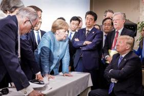 merkel-trump-g7-german-government-handout-6-9-18